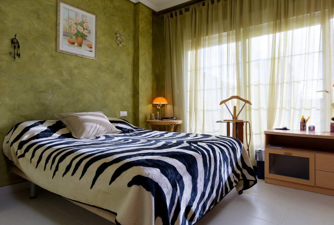 Dormitorio principal tonos verde